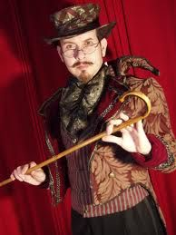 The ringmaster of a dark circus could wear glasses - costume with glasses