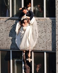 Bride to be, attempts suicide after her lover called off wedding. The man in top window caught her.