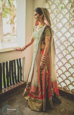 red and green lehenga, cream dupatta, gujarati lehenga, red white and green, panetar colors, big border