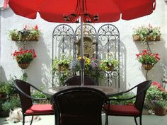 Garden on the Wall -  This patio gains Mediterranean flair with a beautiful arrangement of planters and trellis.