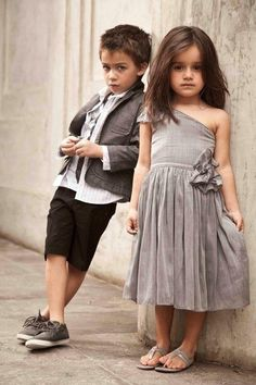 This sassy picture makes the flower girl and ring bearer a little less cutesy and more mature