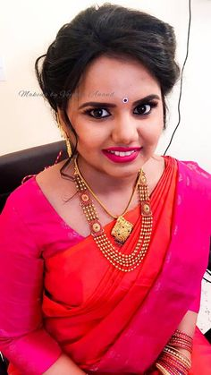Varsha looks simple yet elegant for her engagement ceremony. Hair and makeup by Vejetha for Swank. Pink lips. Indian bridal makeup. South Indian bride. Gold jewellery. Eye makeup. Bridal hair.