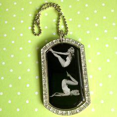 Gymnastics Dog Tag Pendant, Perfect gift for gymnastics coach. $27.00, via Etsy.