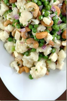 Crunchy Salad with Cauliflower, Peas, Celery, Red Onion, Roasted Cashews,Gouda Cheese and Topped with Buttermilk Ranch Dressing.