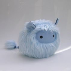 Furry blue plush toy monster. This year I wanted to make some designs that were a little smaller. I used a light blue shaggy fun fur for his body