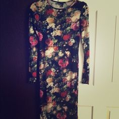 Beautiful body con floral dress Perfect condition . A little sheer . Super tight and sexy . A way to show off your curves along with these beautiful roses :-) Forever 21 Dresses Long Sleeve