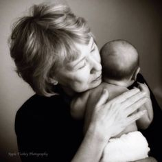 Grandmothers love holding babies...in our grandchildren we get glimpses of our own babies again...what blessings