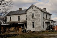 Empty Amish farmhouse in Eastern Ohio - Buggy on the front porch, hay and firewood on the back porch. Hay inside the house.