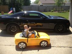 I snapped this picture of my son Vito when you got into his little yellow Camaro and stopped in front of my new Camaro ZL1 giving me the thumbs up. It has won the GM photo of the day on Facebook.