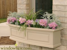 "The new Presidential window box features a bowed front, raised panel design, pronounced crown molding detail and built-in overflow drains. Decorative brackets offer a beautiful finishing touch with a classic look (deck rail brackets sold separately). Sub-irrigation water system encourages root growth. Our molded plastic planters are made from high-grade polyethylene, double wall design and includes 2 steel wall mount brackets with a black powder coated finish. Inside dimensions are 8""W x…"
