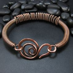 Copper bangle bracelet. Wrapped coil. Hand-forged wire clasp. Copper bracelet created with copper wire. I use .999 pure copper wire for my wire-work creations. This piece has been oxidized and polished, and is finished with one of my hand-forged Ozmay Designs wirework clasps. My wrist is about 7 inches and this bracelet fits me just right! Item will arrive well packaged, in a gift box or pouch. ______________________________________ For more pretties, please re-enter my shop here:...