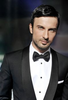 Really, a classic tux looks good on anybody and really fits into any theme you are planning.  It's a man's little black dress!