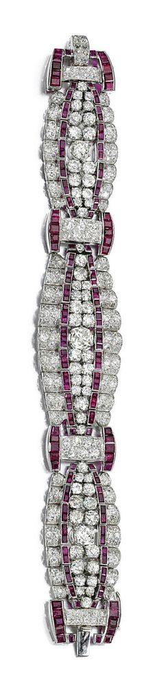 RUBY AND DIAMOND BRACELET, 1930S.  The tapered band designed as a series of arched links, set with cushion-shaped, circular- and single-cut diamonds accented with calibré-cut rubies, length approximately 190mm.
