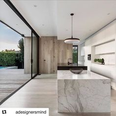 #Repost @adesignersmind Award winner of the International Property Awards Asia Pacific- Single Residence ・・・ Just a simple, classic and beautifully minimalist kitchen from @lsa_architects 🖤🖤🖤 Droplet Pendant from @copper_id ▪️ #kitchendesign #architecture #interiordesign #lifestyle #interior