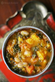 Kale and Roasted Vegetable Soup ~ A hearty winter soup recipe with kale, white beans, and roasted carrots, butternut squash, tomatoes, onions, and garlic.   ~ SimplyRecipes.com