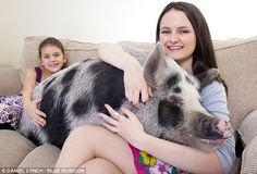 This little piggy: Melissa White with her younger sister Alice and their pet porker Henry, who they bought thinking he was a micro-pig but turned into a real hog