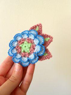 Delicate crocheted flower brooch vintage yarn by BinkleBlossoms,