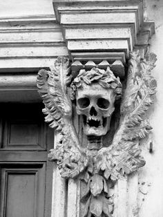 skull decoration outside on either side of the door