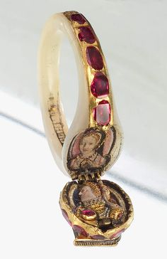 Queen Elizabeth I's ring. Mother of pearl, rubies, diamonds. The contents of the locket were not fully discovered until Elizabeth's death in 1603. It contains a picture of Elisabeth I and what is believed to be her mother, Anne Boleyn. http://static.messynessychic.com/wp-content/uploads/2012/10/ring2.jpg