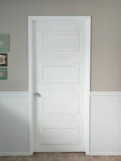 Recycle the old orange 60s doors into a chic panel door by adding framed rectangles and paint white!