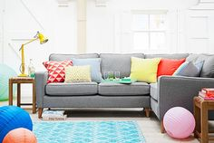 In the living room, pale lemon, cool coral and baby blue combine for a look that's fresh and inviting. A palette of pretty pastels and citrus brights never fails to set the tone for Spring.