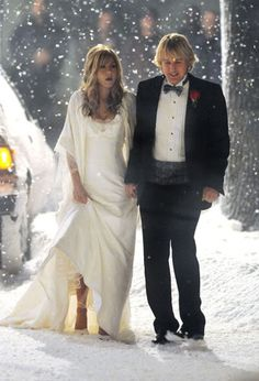 Beginning of Marley and me. They're walking outside from their wedding dress in the snow. An outdoor wedding with falling snow would be so pretty.