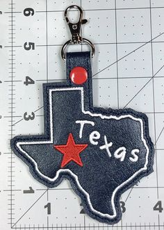 NOTE: THIS IS NOT A PHYSICAL OR FINISHED ITEM. This is a DIGITAL design file to be used with an embroidery machine. NO REFUNDS will be offered to anyone who purchases this item by mistake.  Our Texas tag key fob makes a great (and useful) gift for any Texan or Texas lover.  This unique Texas Key Fob Key Chain Snap Tab is made completely in your hoop. This design fits well within a 5x7 hoop. The state is outlined with a nice satin stitch and includes a star and the word Texas. The layers of…