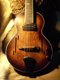 """Wicked abstract interpretation of F-holes on a equally wicked torso! The Land Parlor Guitar - 23"""" scale listed at $US 995 in 2013. A bargain!"""