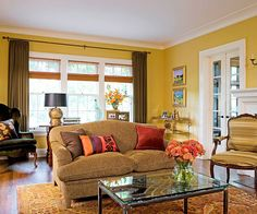 Butterscotch + Chocolate + Raspberry This inviting living room is as luscious a. Butterscotch + Chocolate + Raspberry This inviting living room is as luscious as a warm, rich dess Yellow Walls Living Room, Living Room Colors, Living Room Paint, Living Room Decor, Dining Room, Sweet Home, Room Color Schemes, Colorful Curtains, Curtains Yellow Walls