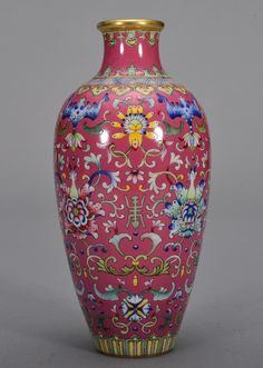 Qing period. The vase is wide cylinder-shaped. The exterior is decorated with flowers and stems. The base is designed with four Chinese characters. 8 1/16 in. tall.