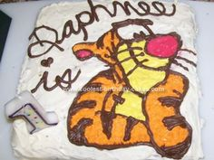 Homemade Tiggy Cake: My baby loves Tigger and calls him Tiggy so for her birthday I knew I had to make a Tiggy cake. I used a boxed cake mix and baked it in a square 8x8 pan.