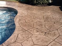 Darker Concrete Stain Colors On Pool Decks Can Really Make The Color Of Water