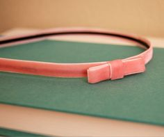 The prettiest headband you'll ever DIY. Petite bow in pale pink velvet ribbon.