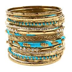 15-piece silk-wrapped bangle set with intricate detailing and Austrian crystals. These bangles are made with real silk and the threaded bangles are very delicate. Due to the fragile nature of silk thread, threaded bangles should be worn with extra care.