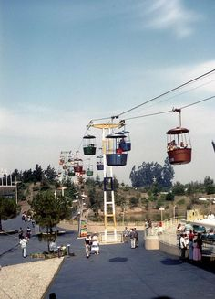 Pre-1959 Skyway buckets glide to and from the Tomorrowland station over Autopia and Holiday Hill (before the Matterhorn), Disneyland ,CA.
