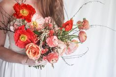 Petaline Floral, Fine Art Floral Designer based in Tennessee, Warm + vibrant wedding palette featuring shades of coral, orange, pink and blush, using raununculus, poppies, spirea, pieris