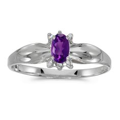 10k White Gold Oval Amethyst And Diamond Ring (Size 8). Beautiful complimentary gift box included with this purchase. Setting made entirely with genuine solid 10 karat gold. Main stone size: 5x3 mm. All gemstones are genuine. 30 Day Satisfaction Guarantee.