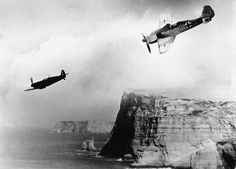FW-190, diving behind a Spitfire on the cliffs of the English channel