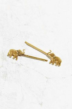 Shiny metal bobby pins topped with mini elephant charms. Comes with 2 pins. Content + Care- Set of Mixed metal- Wipe clean- ImportedSize- Length: Width: . Elephant Icon, Elephant Colour, Elephant Love, Elephant Stuff, Old Gringo, Scarf Jewelry, Jewelry Dish, Jewellery, Color Dorado