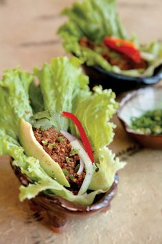 Tacos  2 cups of raw walnuts         1 1/2 teaspoons Cumin powder         3/4 teaspoon Coriander         2 tablespoons Bragg's         pinch of cayenne     Blend the ingredients in a blender or food processor until the consistency of ground meat.the put in a Taco shell of lettuce and garnish with Avocado onion and bell peppers