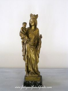 This is a stunning antique French bronze statue of the Crowned Madonna Child It stands 36cms tall of 14 1 8 rdquo It has a commemorative plaque on