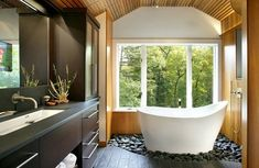 Loose stones conceal a drainage basin for overflow from the freestanding Ofuro bathtub