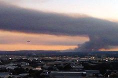 Plane lands during burn off, Sydney  Audience submitted: Paul Bedwell  10/09/2012