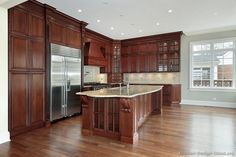Traditional Dark Wood-Cherry Kitchen Cabinets with wood floor