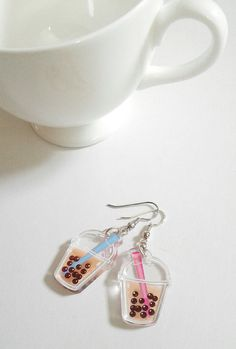 Love for bubble tea/boba! The straw is blue on one side and pink on the other so they are total reversible, the tapioca beads are translucent, and the milk tea is totally opaque. Food is fashion!  The charms were printed by ink it labs, and designed/assembled by me, the Gorgonist! The ear wires are silver-plated, but if you have sensitive ears they may not be perfect for you.