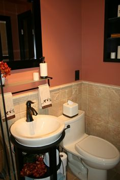 love this coral paint color with the black and oil rubbed bronze accessories