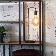 The industrial table lamp Canton is a table lamp with a sleek U shaped frame. With the black frame in combination with the open visible light source, this is a trendy and contemporary table lamp. Can be combined in different interiors. Lampe Industrial, Industrial Floor Lamps, Industrial Interiors, Arc Lamp, Drop Lights, Flooring Sale, Contemporary Table Lamps, Beautiful Lights, Minimalist Design