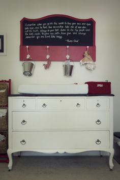 We love a vintage dresser turned changing table! #vintage #nursery