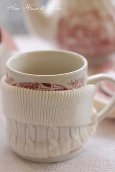 Tea cup cozy made from the sleeve of an old sweater.
