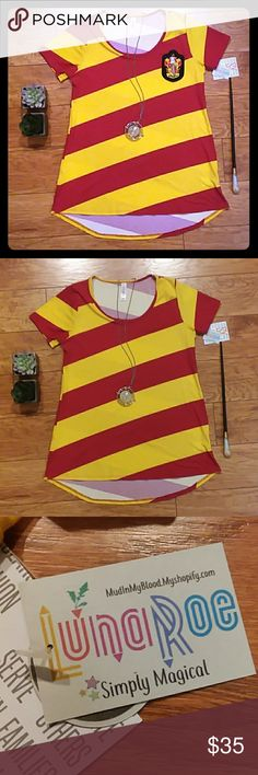 """🦁💛❤ Gryffindor """"Luna-Roe"""" Striped Classic Tee This classic T from lularoe has scarlet and gold stripes. You can purchase this shirt with or without the Gryffindor Crest attached. Please message me if you would prefer to purchase it without the patch. It's great for any Harry Potter fan! LuLaRoe Tops"""